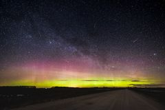Aurora Borealis in the night sky. Stary sky above gravel road in lithuanian fields. Aurora Borealis in the night sky. Stary sky above gravel road in lithuanian Royalty Free Stock Images