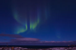 Aurora Borealis. (Northern Lights) above coastal sea Royalty Free Stock Images