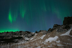 Aurora Borealis or Northern Lights above the mountains, Iceland Stock Photos