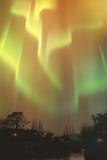 Aurora borealis, northern lights above village Royalty Free Stock Photography