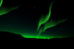 Aurora Borealis, Northern Lights. Beautiful northern lights over mountain Stock Images