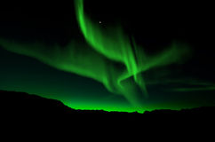 Aurora Borealis, Northern Lights. Beautiful northern lights over mountain Royalty Free Stock Photos