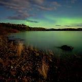 Aurora borealis (Northern lights) display. Intense Aurora borealis in moon lit night being mirrored on Lake Laberge, Yukon T., Canada Stock Image