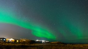 Aurora Borealis, Northern lights in Iceland. Aurora Borealis, known as Northern lights, is amazing green color light over night sky in high lattitude region Royalty Free Stock Photography