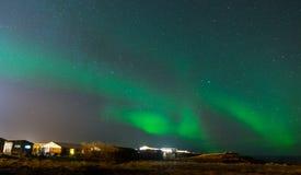 Aurora Borealis, Northern lights in Iceland. Aurora Borealis, known as Northern lights, is amazing green color light over night sky in high lattitude region Stock Photo