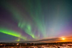 Aurora Borealis, Northern lights in Iceland. Aurora Borealis, known as Northern lights, is amazing green color light over night sky in high lattitude region Royalty Free Stock Photo