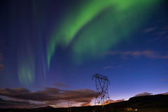 Aurora borealis or Northern lights, Iceland. Green Aurora borealis or Northern lights and high voltage tower, Iceland Royalty Free Stock Photography