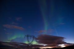 Aurora borealis or Northern lights, Iceland. Aurora borealis or Northern lights and high voltage tower, Iceland Stock Images