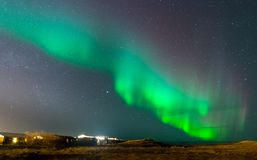 Aurora Borealis, Northern lights in Iceland. Aurora Borealis, known as Northern lights, is amazing green color light over night sky in high lattitude region Stock Images