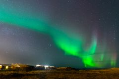 Aurora Borealis, Northern lights in Iceland. Aurora Borealis, known as Northern lights, is amazing green color light over night sky in high lattitude region Royalty Free Stock Images