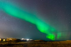 Aurora Borealis, Northern lights in Iceland. Aurora Borealis, known as Northern lights, is amazing green color light over night sky in high lattitude region Royalty Free Stock Image