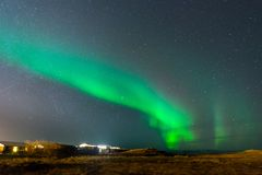 Aurora Borealis, Northern lights in Iceland. Aurora Borealis, known as Northern lights, is amazing green color light over night sky in high lattitude region Stock Photography