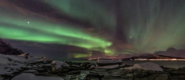 Aurora borealis - northern lights - North Norway - banner. Amazing aurora borealis - northern lights - view from coast in Oldervik, near Tromso city - north stock images