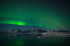 Aurora Borealis or Northern Lights over the glacier lagoon Jokulsarlon, Iceland Royalty Free Stock Image