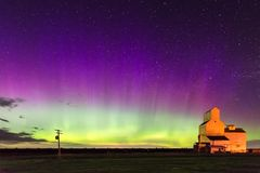 Aurora Borealis Northern Lights over Grain Elevator in Pennant, Saskatchewan. Aurora Borealis Northern Lights over a historical and disappearing prairie landmark Stock Photos