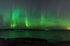 Aurora Borealis or Northern Lights. Northern Lights (Aurora Borealis) Over a lake in Norway at night Stock Photography