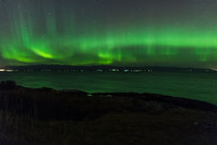 Aurora Borealis or Northern Lights. Northern Lights (Aurora Borealis) Over a lake in Norway at night Stock Images
