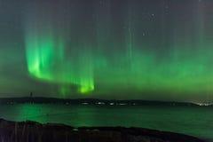 Aurora Borealis or Northern Lights. Northern Lights (Aurora Borealis) Over a lake in Norway at night Stock Image