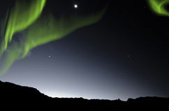 Aurora Borealis, Northern Lights. Over mountains Royalty Free Stock Image