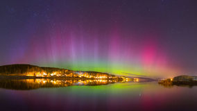 Aurora Borealis. (nothern lights) over the lake Royalty Free Stock Image
