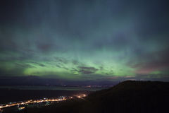 Aurora Borealis over alaskan towns royalty free stock images