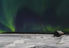 Aurora borealis over the bay of the White sea near the village of Nilmoguba, Karelia, Royalty Free Stock Photos
