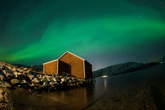Aurora borealis over boat shed Stock Images