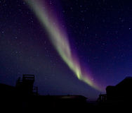 Aurora Borealis over a building silhouette Stock Photography