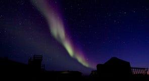Aurora Borealis over a building silhouette Stock Photography