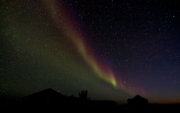 Aurora Borealis over a building silhouette Royalty Free Stock Images