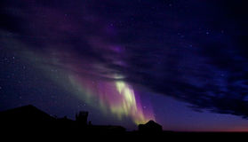 Aurora Borealis over a building silhouette Royalty Free Stock Photos
