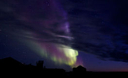 Aurora Borealis over a building silhouette Royalty Free Stock Photography