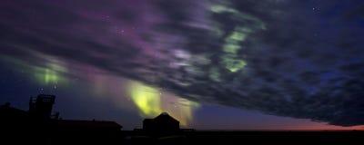 Aurora Borealis over a building silhouette Stock Image