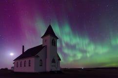 Aurora Borealis over church in Saskatchewan, Canada. Aurora Borealis over the historical St. John's Lutheran Church established in 1919 near Cabri Royalty Free Stock Image