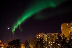 Aurora borealis over city buildings Stock Image