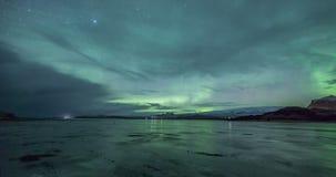 Aurora borealis over frozen lake stock video footage