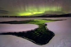Aurora Borealis over the frozen river. The River Sob. Polar Urals. Russia stock image
