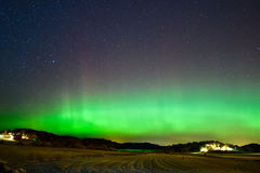 Aurora borealis over Goksjø. Northern light seen in Southern Norway Royalty Free Stock Image