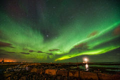 Aurora Borealis over Gróttuviti. Northern Lights over the Lighthouse of Grotta, Reykjavik, Iceland Royalty Free Stock Images