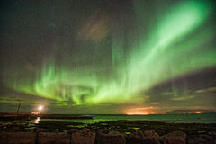 Aurora Borealis over Gróttuviti. Northern Lights over the Lighthouse of Grotta, Reykjavik, Iceland Royalty Free Stock Image