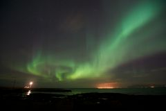 Aurora Borealis over Gróttuviti. Northern Lights over the Lighthouse of Grotta, Reykjavik, Iceland Royalty Free Stock Photography