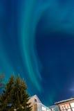Aurora borealis over houses in Tromso Royalty Free Stock Image
