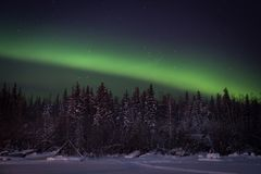 Aurora Borealis over Jolliffe Island, Yellowknife royalty free stock photo