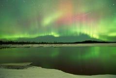 Aurora Borealis over lake. Aurora Borealis Northern Lights over lake in Fairbanks Alaska in winter stock photos