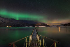 Aurora borealis over a norwegian fjord Royalty Free Stock Image