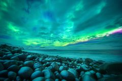 Aurora borealis over ocean. Northern lights royalty free stock photography