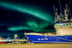 Aurora borealis over Reykjavick boat harbour. A clear night with strong aurora borealis activity over Reykjavick`s boat harbour in Iceland Stock Photography