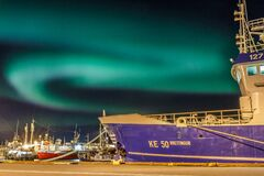 Aurora borealis over Reykjavick boat harbour in Iceland