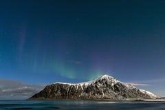 Aurora borealis over Skagsanden beach on Lofoten Islands Stock Photo