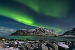 Aurora borealis over Skagsanden beach on Lofoten Islands, Stock Photos
